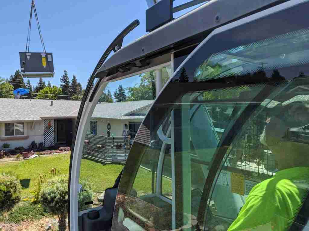 Sacramento crane operators positioning HVAC unit